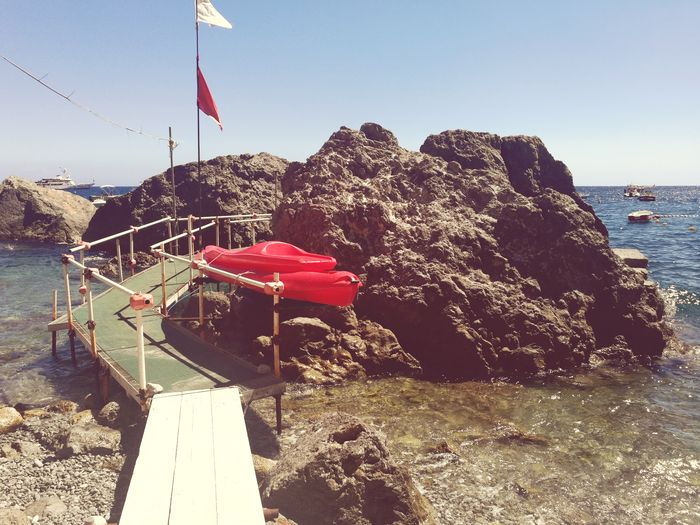 Live boats Flag Sea Red Outdoors No People Water Day Beach Sky Nature Boat Boats Amalfi Italy Sunlight The Week On EyeEm Mobile Photography Nature Ocean Seaview Italy Travel Destinations Travel Photography Beach Life Beach Photography Travel
