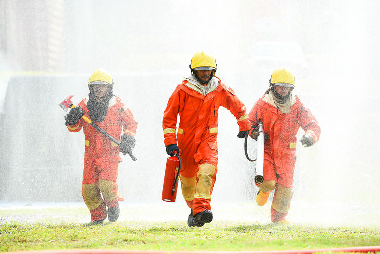 Group of people working in water