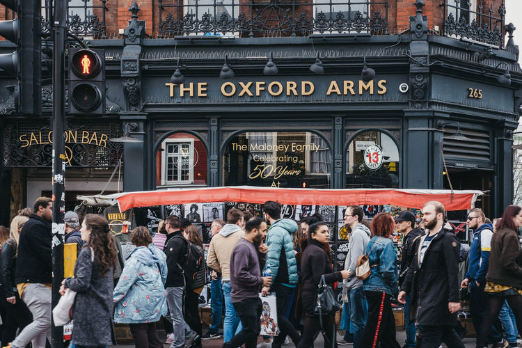 People walking in front of The Oxford Arms pub in Camden, London, an area famed for its market and nightlife and popular with tourists, teenagers and punks. Architecture Group Of People Real People Large Group Of People Lifestyles Street Outdoors Leisure Activity City Life City Crowd Busy Motion Blur Motion Traditional English Pub Public Transportation North London Camden Town The Oxford Arms Uk London