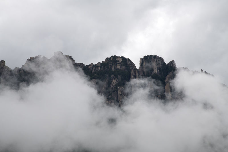 cloudy Ulsanbawi at Seolak Mountain in Gangwondo, South Korea Gangwondo Seolak Mountain Beauty In Nature Cloud - Sky Day Environment Fog Formation Geology Mountain Mountain Range Nature No People Non-urban Scene Outdoors Rock Rock - Object Scenics - Nature Sky Solid Tranquil Scene Tranquility Ulsanbawi