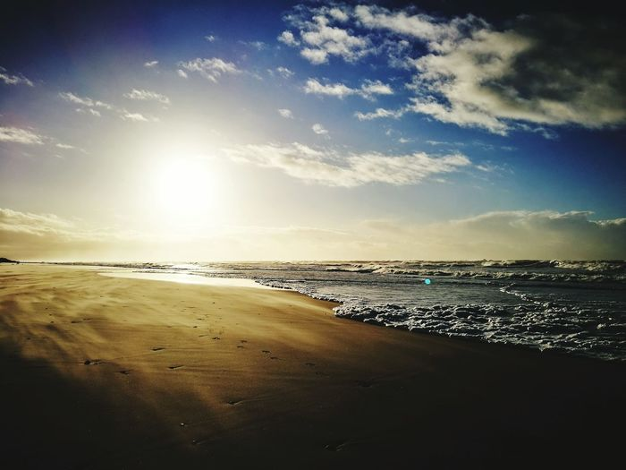 Sea Beach Sunset Sand Water Horizon Over Water Travel Destinations Outdoors Wave Landscape Beauty In Nature Coastline Nature Sun Traveling Home For The Holidays