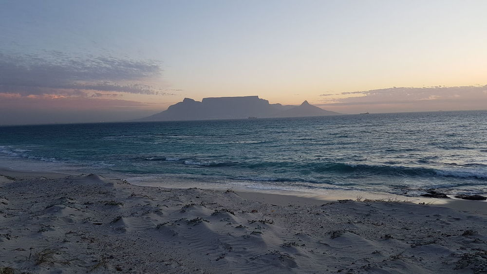 South Africa 🇿🇦 Beauty In Creation  Sunset Landscape Sky Horizon Over Land Clear Sky Beauty In Nature Tranquility Sun No People Nature Outdoors Scenics Sea Beach Sand Silhouette Mountain Cold Temperature Travel Destinations Day EyeEmInCapeTown Perspectives On Nature