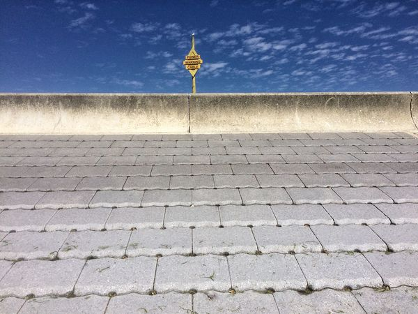 Concrete and signal Wall Sky No People Nature Street Architecture Day Built Structure Outdoors Sign Sunlight Pattern Footpath Cobblestone
