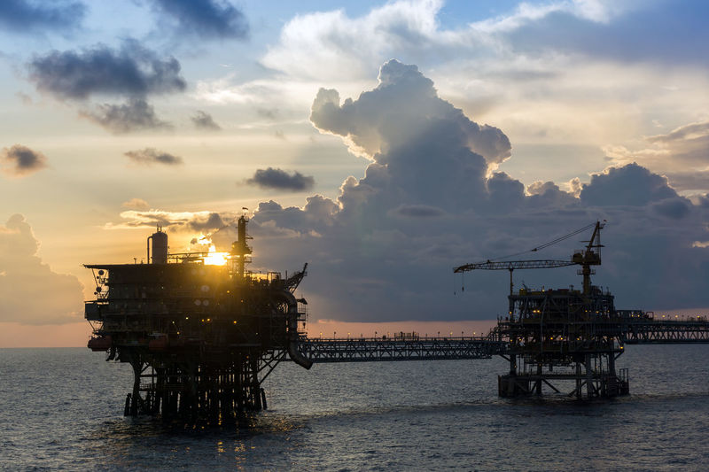 sunset at oil field Production Drilling Gas Oil Rig Ocean Wave Horizon Over Water Cloudy Evening Petroleum Upstream Offshore Offshore Life Oil And Gas Sunset Sea Technology Oil Pump Sun Business Finance And Industry Sunlight Sky Offshore Platform Oil Oil Industry Natural Gas Fossil Fuel Oil Field