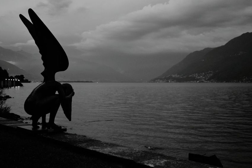 Statue at Lago Maggiore, Bressagio, Switzerland Sculpture Water Statue Silhouette Outdoors No People Beauty In Nature Lago Maggiore Lago Maggiore, Italy Lago Maggiore Morning Scene Blackandwhite Lake View Lakescape Lakeshore Your Ticket To Europe Travel Destinations Waterfront_challenge Lost In The Landscape Connected By Travel Black And White Friday HUAWEI Photo Award: After Dark