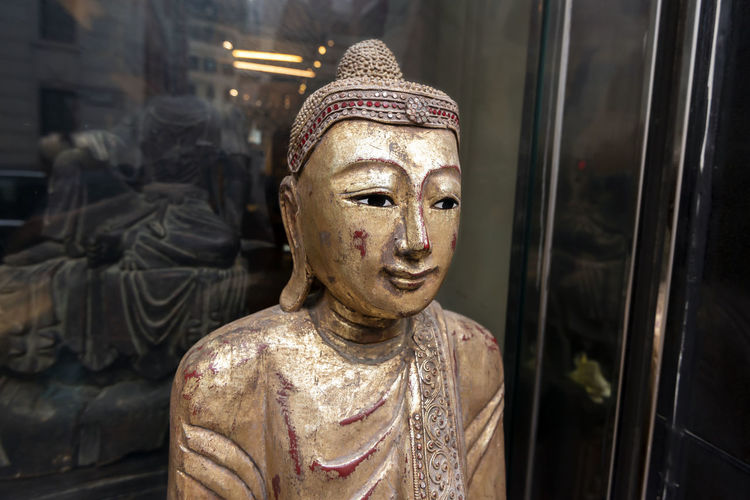 Close-up of statue against temple