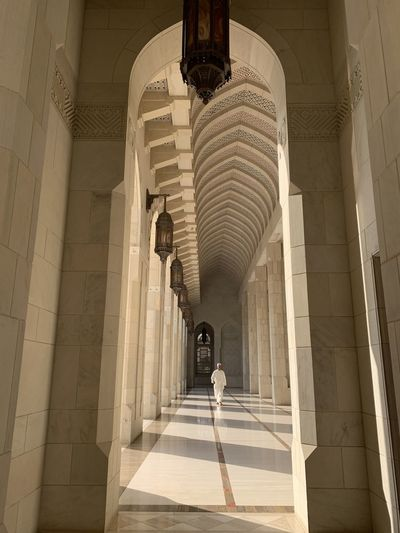 Low angle view of woman walking in corridor of building