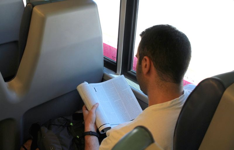 Book Reading Vehicle Interior Mode Of Transport Transportation Young Adult Vehicle Seat Land Vehicle Train Travel Public Transportation Let's Go. Together. Sitting Reading Investing In Quality Of Life Second Acts It's About The Journey