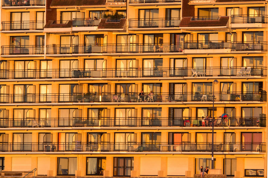 Activity Apartment Apéro Architecture Balcony Building Exterior Calmness Community Dinner Time End Of Day Evening Glow Evening Light Golden Hour Golden Light Mood Outdoor Life Sundown Symmetrical Warm Atmosphere Warm Colors Windows Windows And Doors