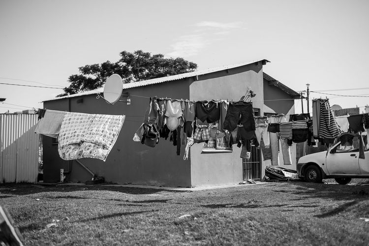 Clothes drying on clothesline against building