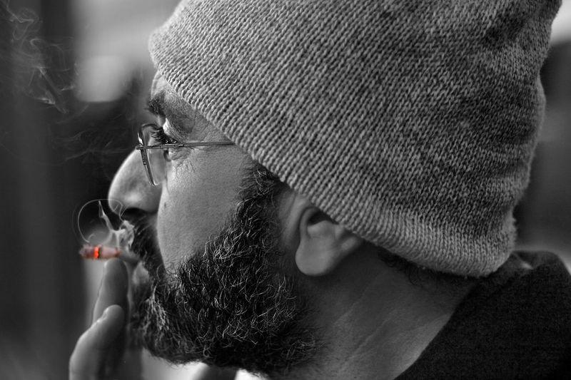 Close-up of bearded man smoking