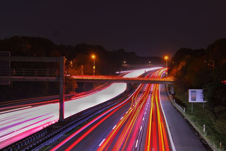 City Illuminated Motion Long Exposure Road Light Trail Speed Street City Life Road Sign Tail Light Vehicle Light Highway Multiple Lane Highway Traffic Traffic Jam Stoplight Thoroughfare Road Intersection Two Lane Highway Green Light Road Signal Elevated Road Headlight Viaduct China World Trade Center Red Light Overpass Rush Hour