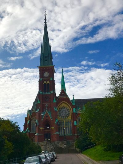 Sweden Religion Cloud - Sky Spirituality Place Of Worship Sky Architecture Built Structure Day No People Building Exterior Cross Outdoors Low Angle View Clock Tower Tree Travel Destinations Bell Tower Nature Clock