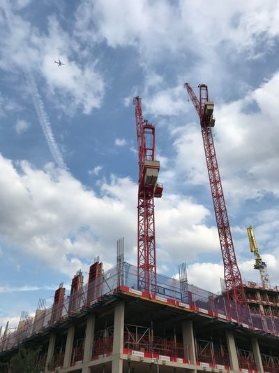 LONDON❤ London Sky Planes And Cranes IPhoneography Clouds Sky Construction Another Tower Goes Up Housing For The Wealthy Developers Heaven Development Construction Site Built Structure Day Crane