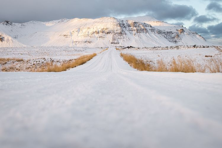 Somewhere in Iceland EyeEmNewHere Shades Of Winter Snow Cold Temperature Winter The Way Forward Road Scenics Weather Landscape Beauty In Nature Nature Tranquil Scene Cloud - Sky Mountain Tranquility Day No People Outdoors