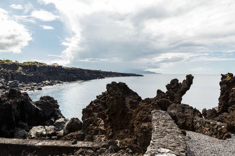 Azores Pico Island Basaltic Rock Beach Beauty In Nature Cloud - Sky Day Dog Rocks Environment Eroded Formation Land Nature No People Non-urban Scene Rock Rock - Object Rock Formation Scenics - Nature Sea Sky Solid Tranquil Scene Tranquility Water