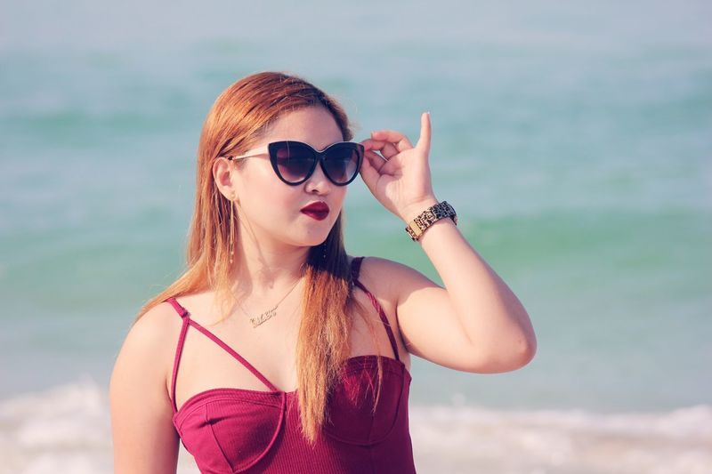 Real People Beautiful Woman Sunglasses One Person Young Adult Beauty Young Women Standing Leisure Activity Portrait Day Outdoors Close-up Nature Sky PhotoBaa EyeEm Gallery This Week On Eyeem EyeEm Best Shots Woman EyeEm Beach Life Bestoftheday Moodygrams Beauty In Nature Summer Exploratorium