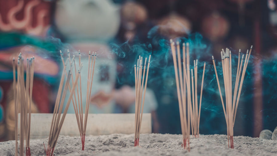 Close-Up Of Incense In Temple