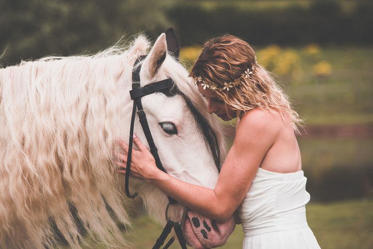 Young Woman Touching Horse