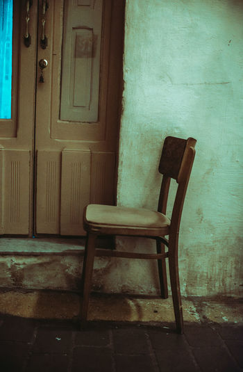 Empty chair in old building