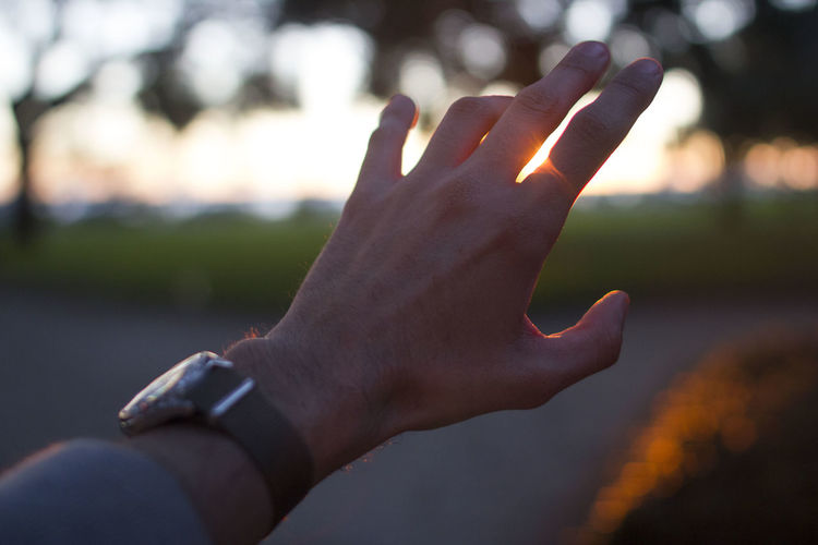 Close-up Day Everything Is Ok Focus On Foreground Human Body Part Human Finger Human Hand Lifestyles Nature One Person Outdoors People Real People Sunrise Sunset Watch