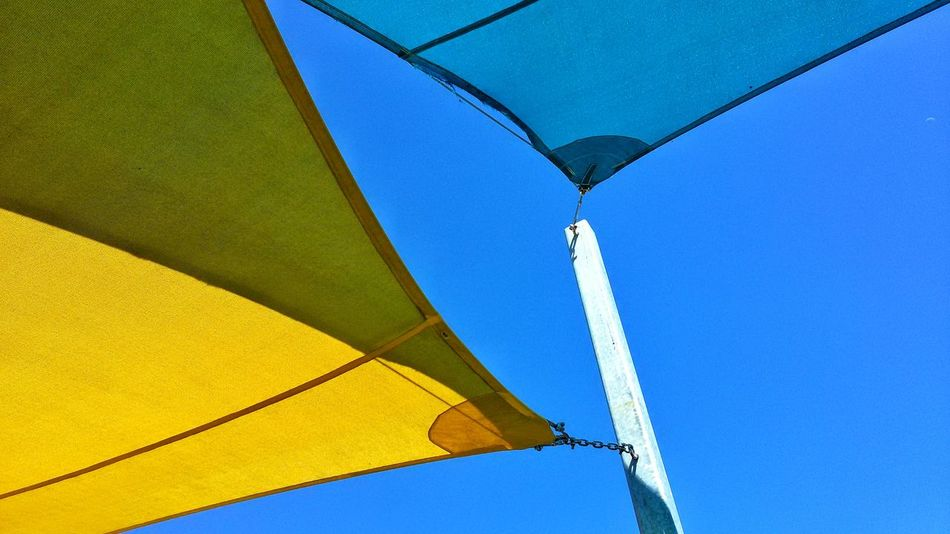 A Tarp composition. Blue Low Angle View Summer Sky Popular Abstract Color Colors Colorful Compositions Unique Perspectives Unique Beauty Modern Art Cafe Time Artistic Blue Sky Contrast Contrasting Colors Shape Shapes And Forms Shapes , Lines , Forms & Composition Design Shapes And Colour Shape And Form