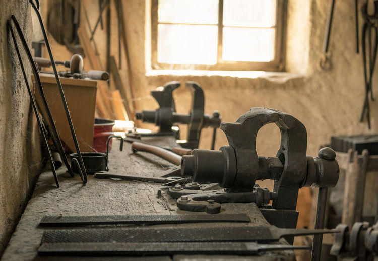 Work tools on workbench in old factory