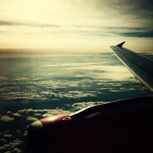 From The Plane Window Traveling Over The Clouds Flying :)