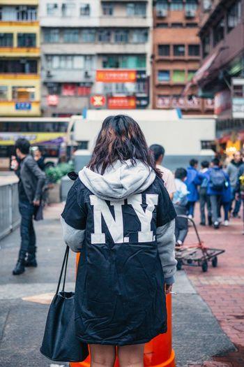 Man standing on city street