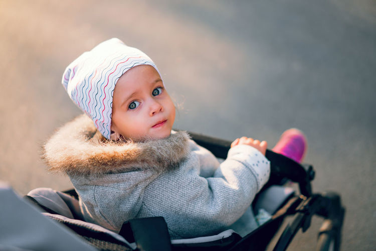 Little caucasian girl outdoors, dressed in the gray fashionable coat and cute hat. Spring or autumn season children collection. Springtime Spring Season  Seasonal Autumn Autumn Collection Children Child Childhood Playground Leisure Activity Leisure Games Lifestyles Outdoors Healthy Lifestyle Little Girl European  Caucasian Girl Daughter Portrait Clothing Hat One Person Winter Warm Clothing Looking At Camera Cute Innocence Headshot Focus On Foreground Girls Cold Temperature Knit Hat Real People