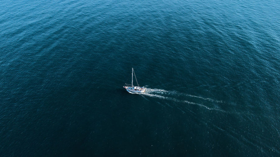 A top view of a boat sailing. DJI X Eyeem Day Dronephotography High Angle View Marine Mode Of Transportation Motion Nautical Vessel Ocean Outdoors Sailboat Sailing Sea Top View Tranquility Transportation Travel Water Yacht