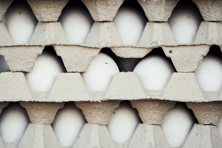 Stack of eggs in cartons for sale at market
