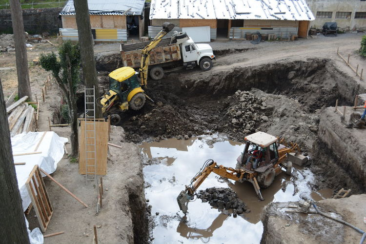 High angle view of bulldozers at construction site