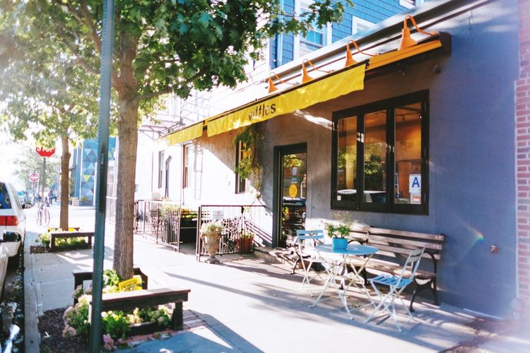 Vittles in Brooklyn, NY near Greenpoint. Architecture Building Exterior Built Structure Awning Chair Table Outdoors Sidewalk Cafe Day Restaurant Cafe Sunlight No People Tree City Coffee Shop Outdoor Cafe Vitto Brooklyn Brooklyn Cafe Coffee Shop Images Coffee Shop Scene