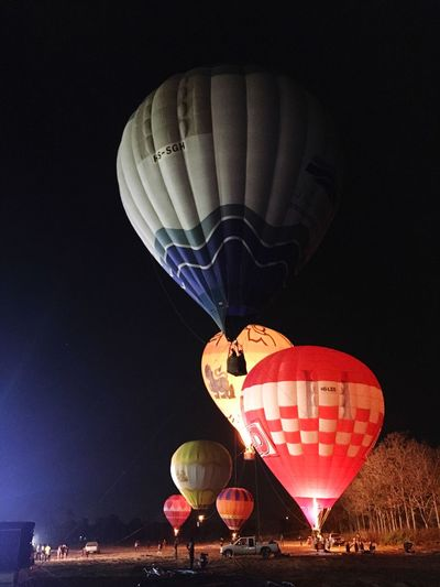 Hot Air Balloon Ballooning Festival Transportation Adventure Flying Basket Night Mid-air Mode Of Transport Travel Air Vehicle Low Angle View Traditional Festival Illuminated Flame Mountain Sky Outdoors Balloon Helium Balloon