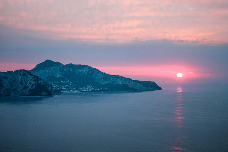 Sky Scenics - Nature Water Beauty In Nature Sunset Tranquility Tranquil Scene Waterfront Sea Idyllic No People Nature Cloud - Sky Non-urban Scene Sun Mountain Orange Color Remote Horizon Over Water Capri Capri, Italy Ocean View From Above Drone  RedSky My Best Photo My Best Photo