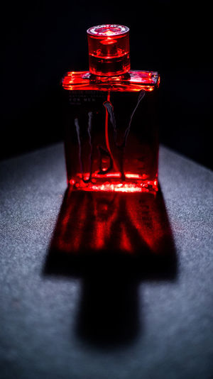 Black Background Red Red Bottle Black Background Close-up Day Illuminated Indoors  No People One Point Light Perfume Perfume Photography Perfume Sprayer Product Photography Red Shadow Snoot Table