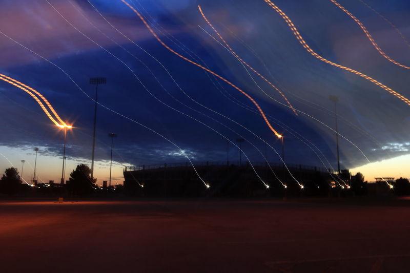 Stadium sunset and light streaks Football Stadium Midland, TX Stadium Lights Blue Silhouette Light Streaks Evening Sky Stadium