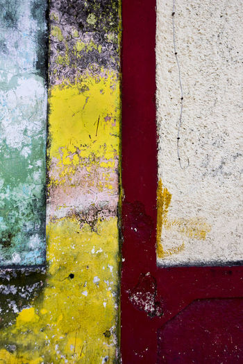 Wall detail in Merida, Mexico Abstract Architecture Backgrounds Building Exterior Built Structure Close-up Day Full Frame Multi Colored No People Old Outdoors Paint Painted Pattern Red Textured  Wall - Building Feature Weathered Yellow