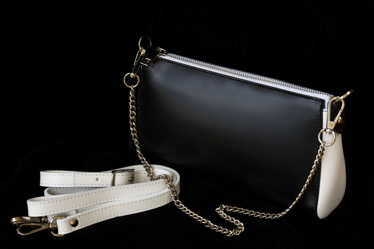 Close-up of leather handbag, always classic combination, black and white color with strap and chain, low key. No logo, no brand. Modern pattern, wallpaper or banner design Black & White Classic Elegant Fashion Leather Shopping Vogue Accessories Bag Black And White Black And White Friday Black Background Blackandwhite Chain Close-up Clutch Combination Genuine Handbag  Leather Bag Low Key Photography Purchases Sale Shopping Texture Trade