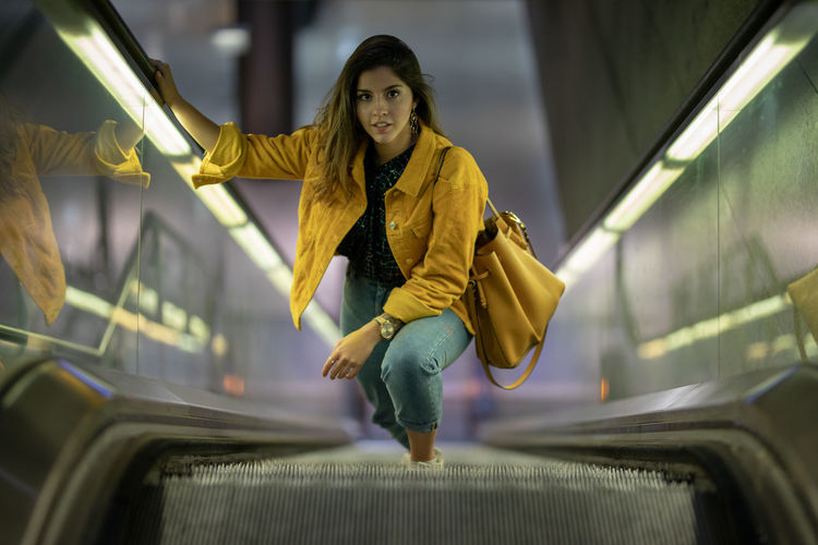 Portrait Of Young Woman On Escalator