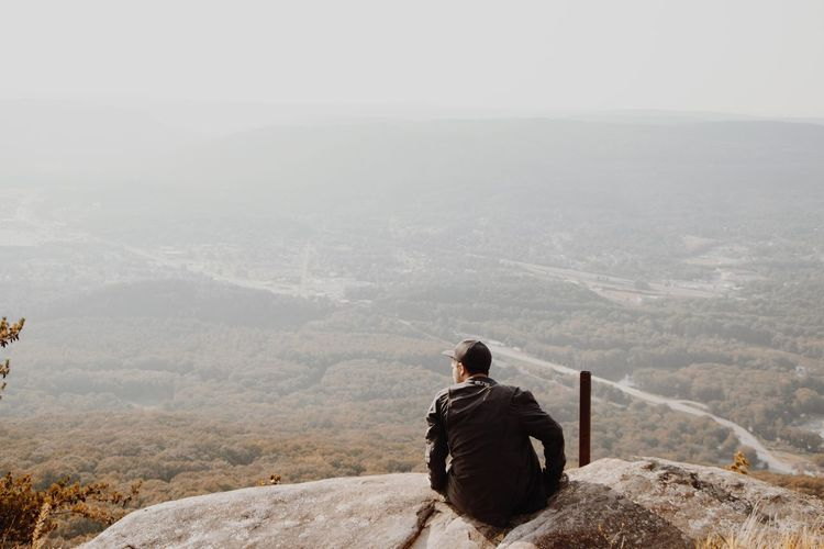Adult Adventure Beauty In Nature Day Fog Hiking Landscape Leisure Activity Looking At View Men Mountain Mountain Range Nature One Man Only One Person Only Men Outdoors People Real People Rear View Scenics Sitting Sky Tranquil Scene Tranquility