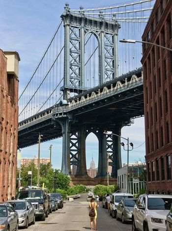 Battle Of The Cities Brooklyn Manhattan Bridge Mamhattan Skyline Empire State Building Architecture Transportation Built Structure Building Exterior City Life Travel NYC Outdoors Majestic Clouds Tranquility People Cars Connection Suspension Bridge Land Vehicle Engineering Arch