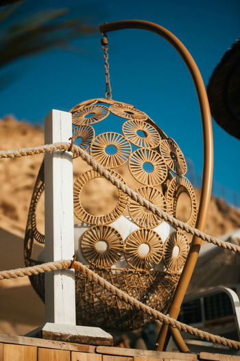 Low angle view of decoration hanging on metallic structure