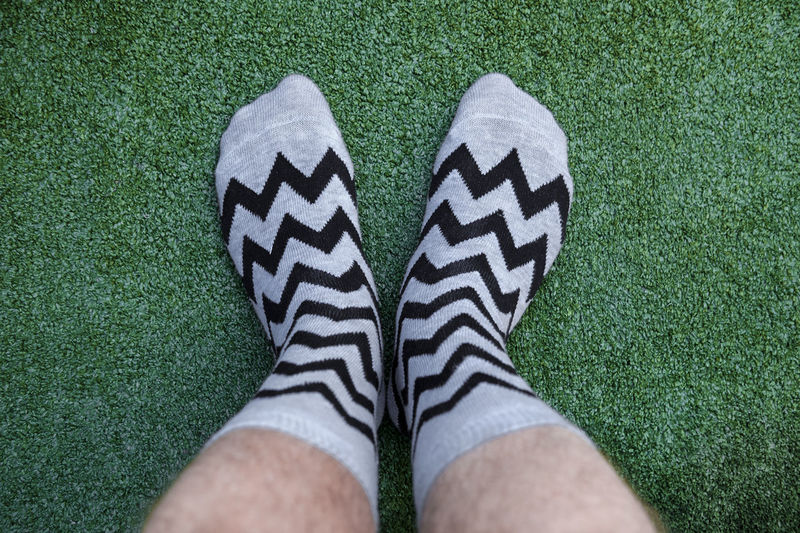 Low section of man wearing socks on field