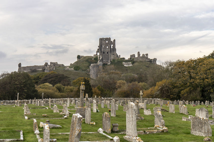 Corfe Castle, Dorset UK, from the village cemetary Castle Castle Ruin Corfe Castle Tombstone Cemetery Grave History The Past Cloud - Sky Built Structure No People Day Outdoors Ruins