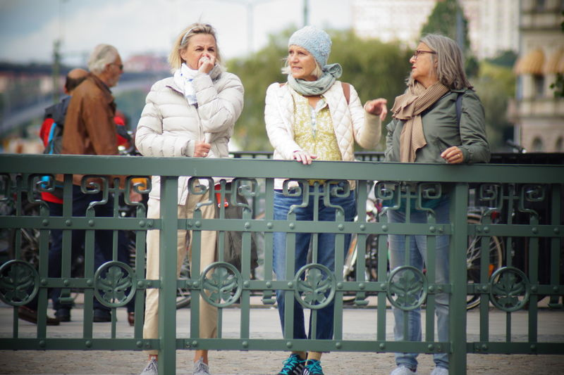 Look like 3 sister's City Friendship Togetherness Happiness Warm Clothing Teenager Bonding Casual Clothing Caucasian Thoughtful Visiting Arm In Arm Reunion - Social Gathering Wearing Mature Couple Posing Friend