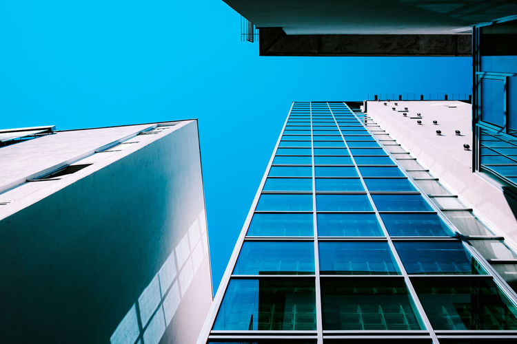 Urban Perspectives Street Photography The Devil's In The Detail Tall - High Built Structure Architecture Building Exterior Building Low Angle View City Sky Modern Day No People Clear Sky Sunlight Office Office Building Exterior Reflection Blue Glass - Material Outdoors Window Directly Below Architectural Feature The Architect - 2019 EyeEm Awards My Best Photo
