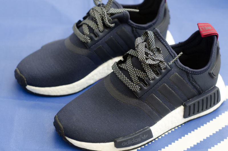 Adidas NMD Collegiate Navy Vintage White shoes close up on blue paper. Fashion Foot Acitivity Adidas Adidas Nmd Authentic Blue Close-up Clothing Excercise Fashion Focus On Foreground Footwear Indoors  Item Lifestyles Pair Pairs Product Shoe Shoelace Shoes Sneakers Street Fashion Teeanger