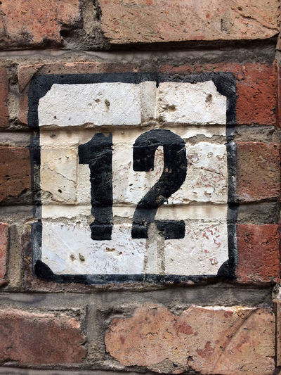 Close-up of number 12 brick wall